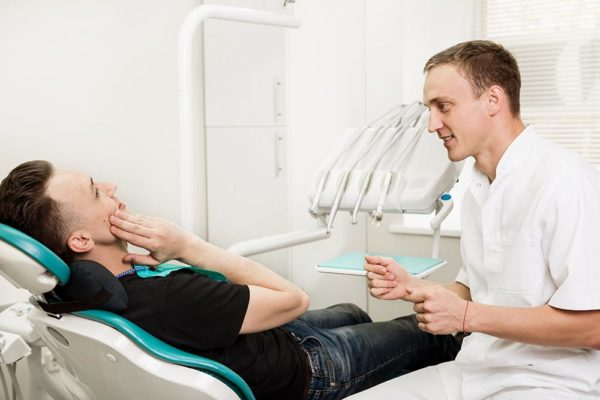 A dentist with his dental implant patient.